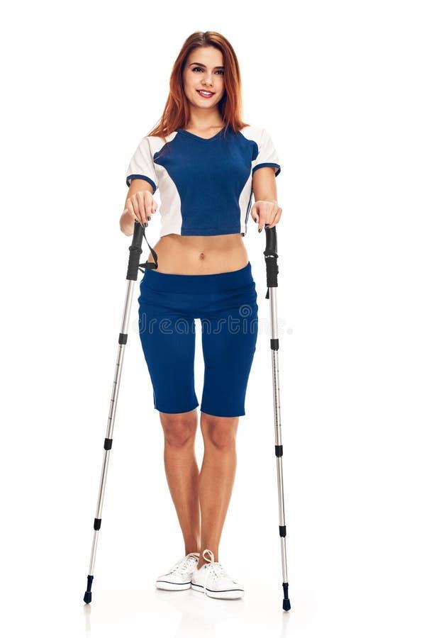 Nordic walking woman. Nordic walking - active people. woman in studio on white background stock photos