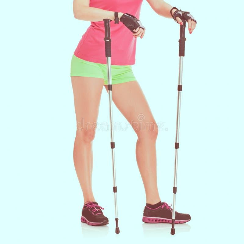 Nordic walking woman. Legs Nordic walking athletic woman posing, image with vintage toning royalty free stock photos