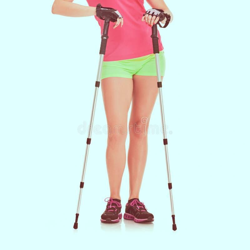 Nordic walking woman. Legs Nordic walking athletic woman posing, image with vintage toning royalty free stock photography