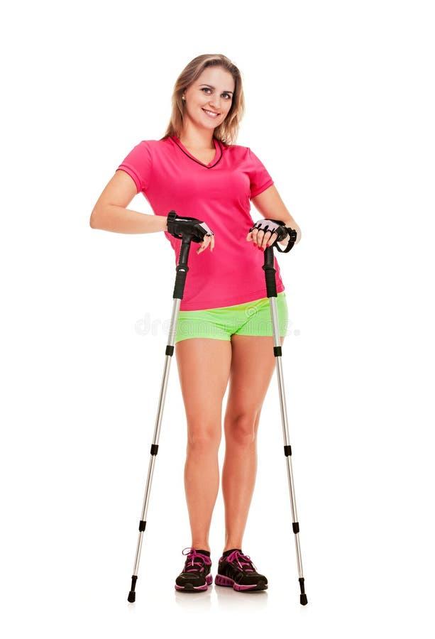 Nordic walking woman. Nordic walking athletic woman posing on white background stock photography