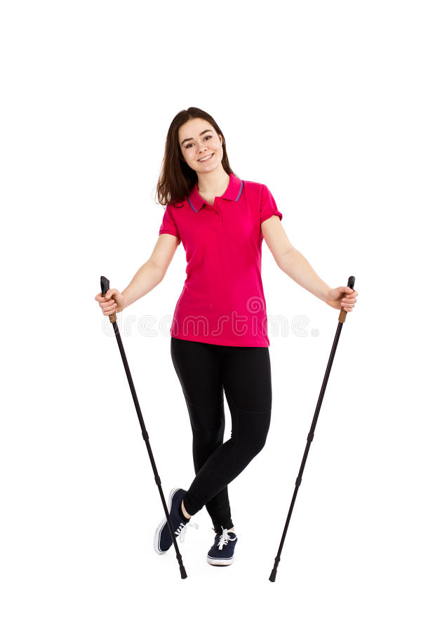 Nordic walking - young woman training. Nordic walking - young woman on white background royalty free stock images