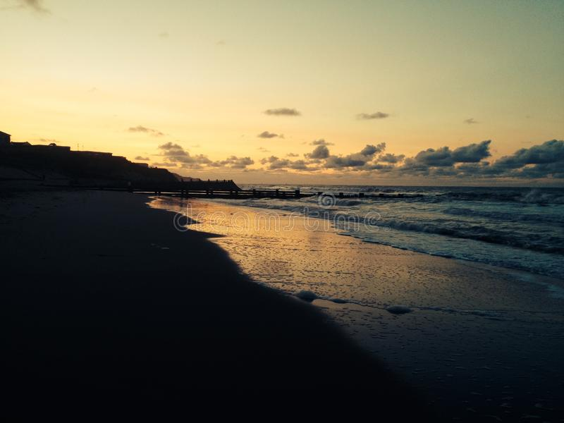 Norfolk beach at sunset royalty free stock images