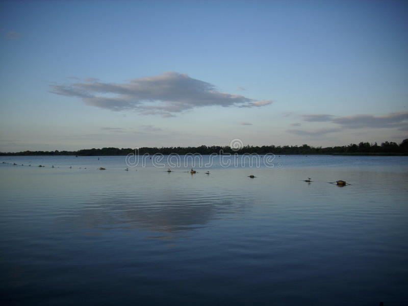 A Norfolk Broad. With blue, calm water and a big blue sky royalty free stock images