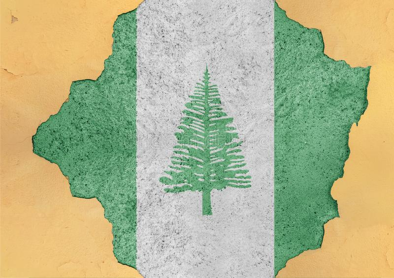 Norfolk Island state flag broken material facade structure in big hole. Norfolk Island state flag broken material facade structure in big concrete cracked hole royalty free stock photography