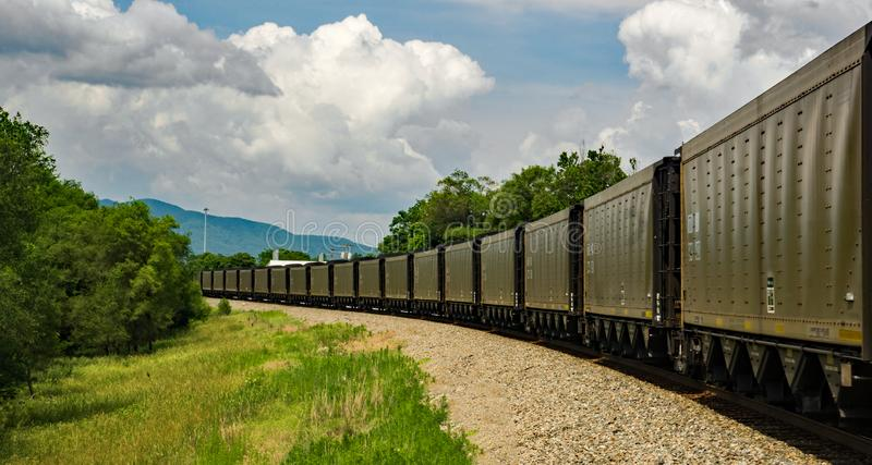 Norfolk and Southern Mile Long Coal Train. Roanoke, VA, May 30th: A mile long Norfolk and Southern Train transporting coal in a coal hopper next to the Roanoke royalty free stock images