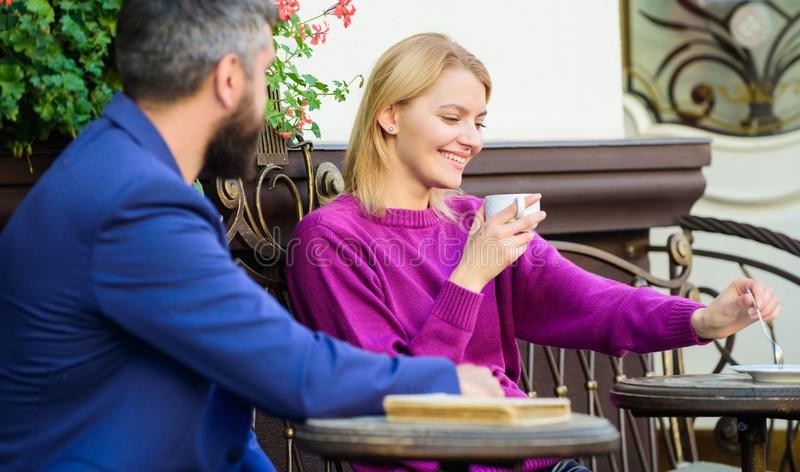 Normal way to meet and connect with other single people. Meet become acquaintances. Meeting people first date. Couple. Terrace drinking coffee. Casual meet royalty free stock image