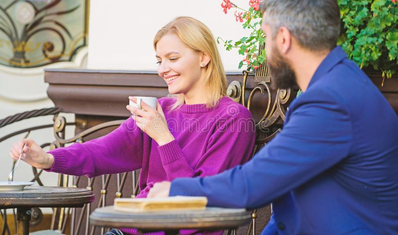 Normal way to meet and connect with other single people. Meet become acquaintances. Meeting people first date. Couple. Terrace drinking coffee. Casual meet royalty free stock photos