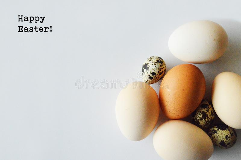 Happy Easter!. Normal white and brown chicken eggs, quail eggs. Isolated on white background. Happy Easter royalty free stock photography