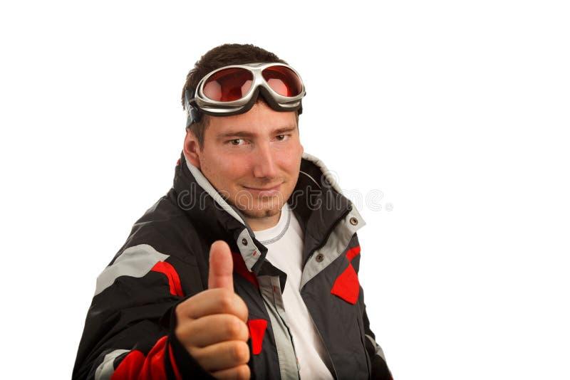 Normaler Mann in den Skischutzbrillen und in der Skijacke stockbild