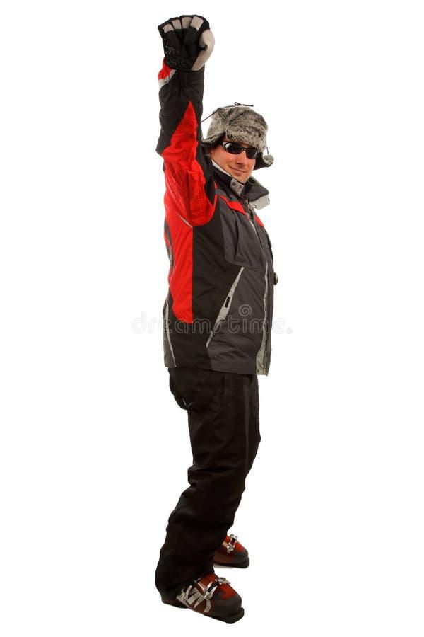 Normaler Mann in einer lustigen Winterhut- und -skijacke lizenzfreie stockbilder