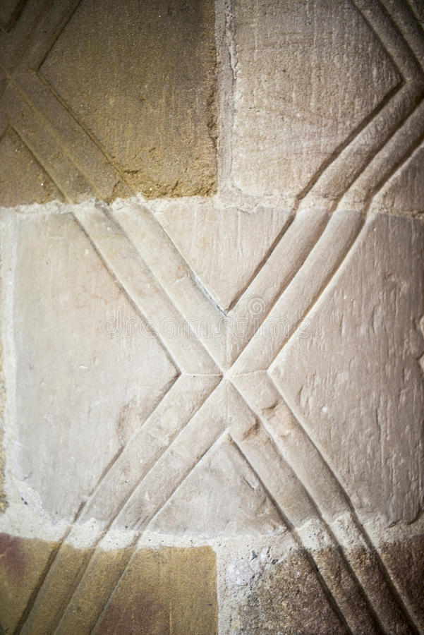 Norman pillars with patterns. Norman pillars in St Mary, Kirkby Lonsdale, Cumbria royalty free stock photography