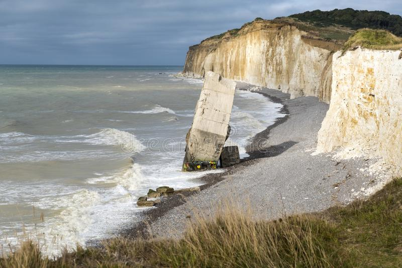 A fallen from the cliff German concrete bunker from World War Two on the beach of Sainte-Marguerite-sur-mer, France stock photos