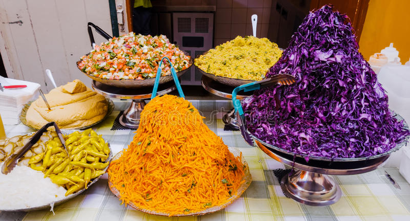 North African Food. A variety of North African food dishes displayed on the counter of a cafe in a market stock image