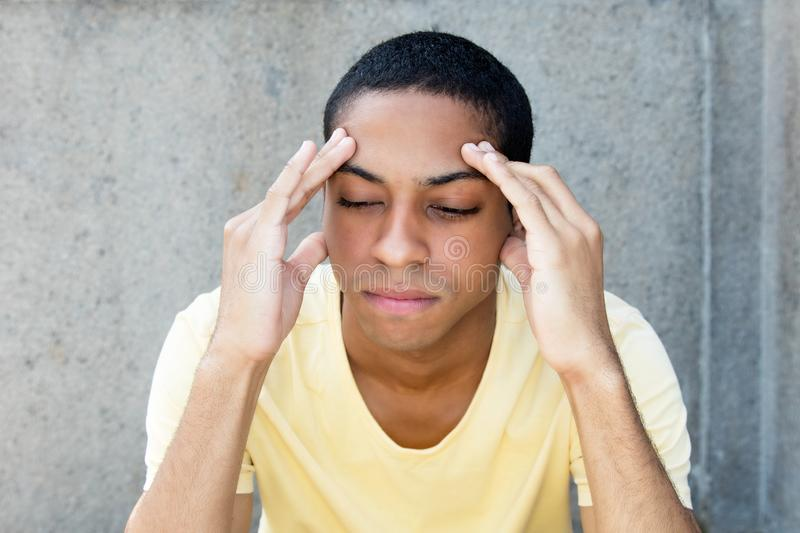 North african man with painful headache royalty free stock photography
