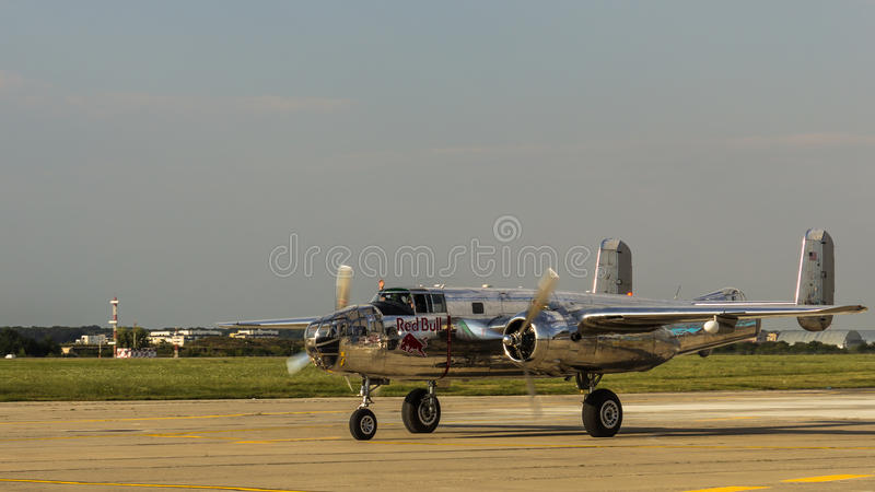 North American B-25 Mitchell. Red Bull (The Flying Bulls) after flight demonstration at Bucharest International Air Show 2013 stock image