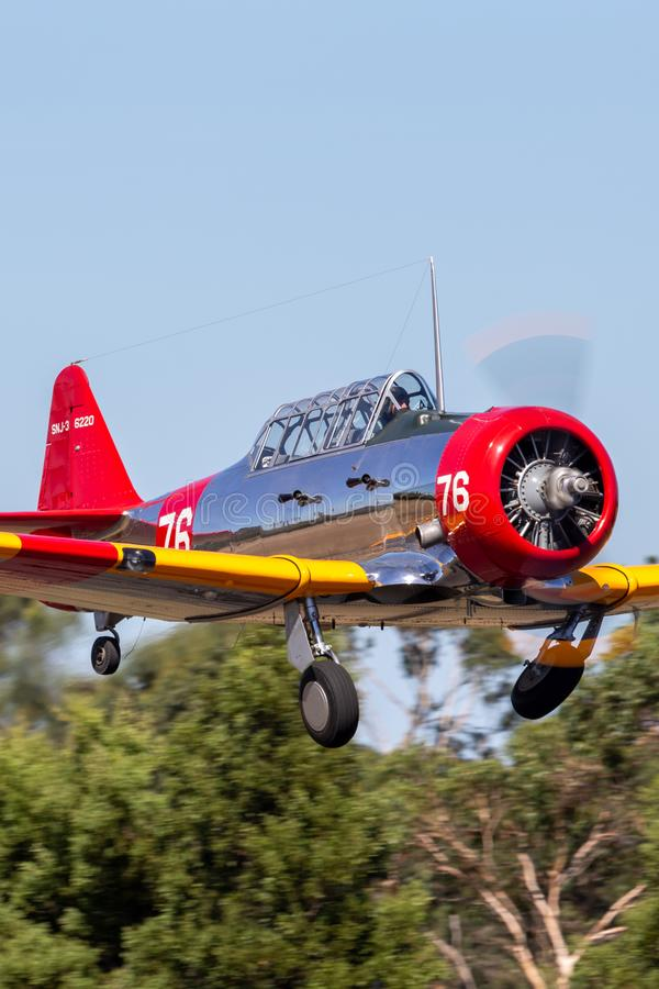 North American AT-6C Harvard VH-NZH single engine military training aircraft in US Navy markings from World War II. Tyabb, Australia - March 9, 2014: North royalty free stock photo
