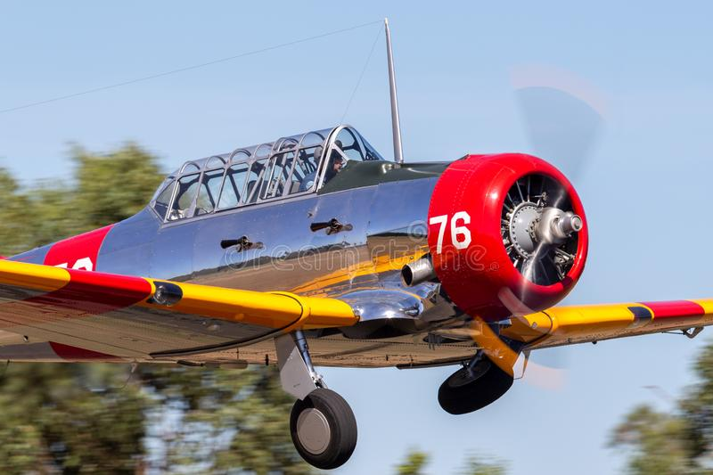 North American AT-6C Harvard VH-NZH single engine military training aircraft in US Navy markings from World War II. Tyabb, Australia - March 9, 2014: North stock photo