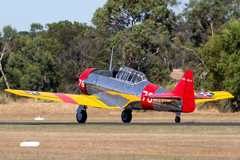 North American AT-6C Harvard VH-NZH single engine military training aircraft in US Navy markings from World War II. Tyabb, Australia - March 9, 2014: North royalty free stock photos
