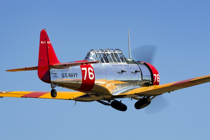 North American AT-6C Harvard VH-NZH single engine military training aircraft in US Navy markings from World War II. Tyabb, Australia - March 9, 2014: North royalty free stock photography