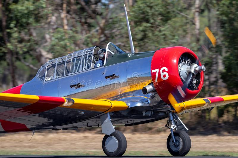 North American AT-6C Harvard VH-NZH single engine military training aircraft in US Navy markings from World War II. Tyabb, Australia - March 9, 2014: North stock image