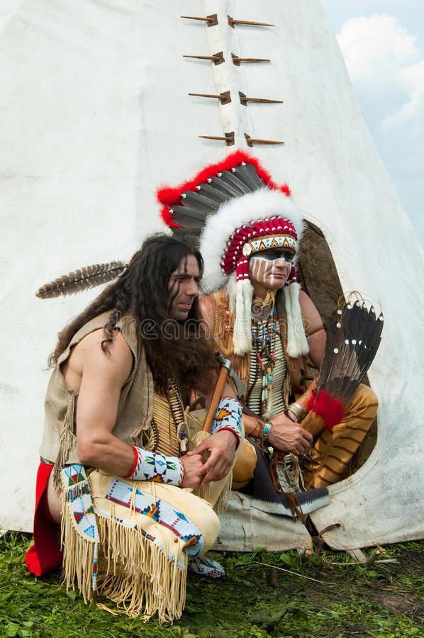 North American Indian. In full dress. Reconstruction royalty free stock image