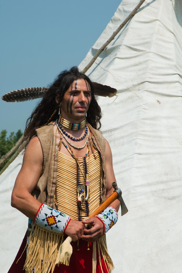 North American Indian. In full dress. Reconstruction stock image