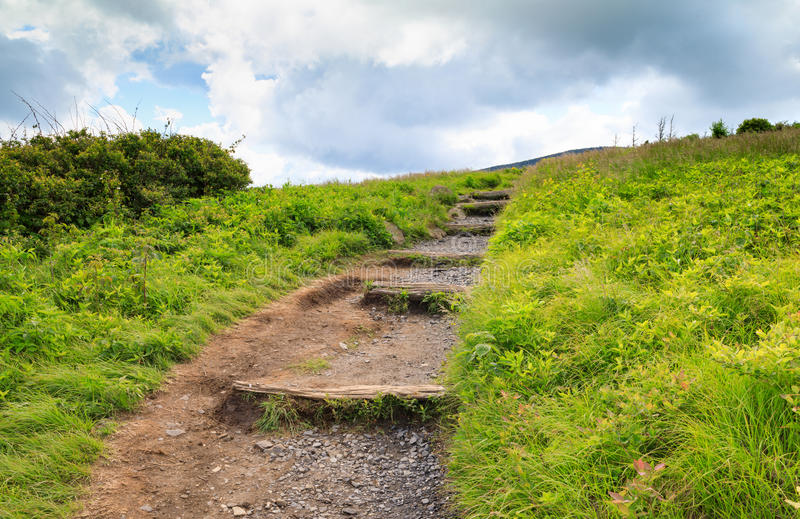 North Carolina Appalachian Trail Roan Mountain. The Appalachian Trail winding up and over Round Bald in the Roan Mountain Highlands of North Carolina along the stock images