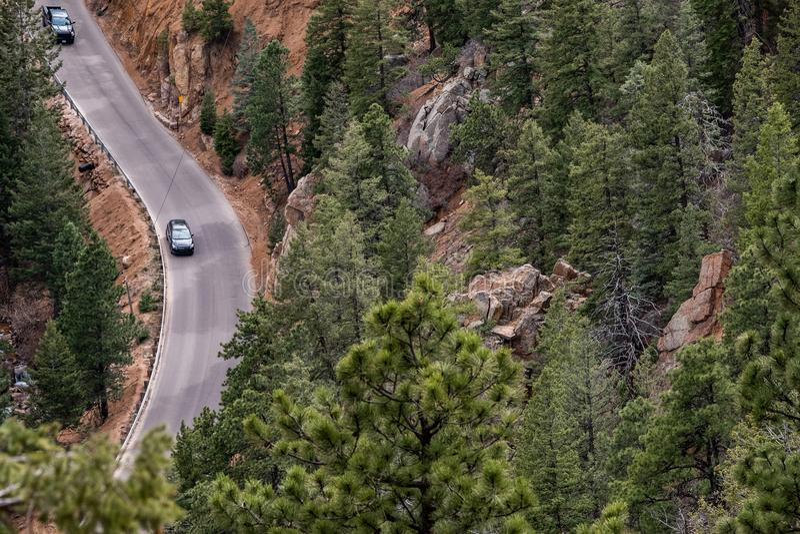 North cheyenne canyon canon colorado springs. Car traveling on mountain road highway through forest in north cheyenne canyon canon colorado springs mountain stock photos