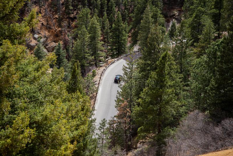 North cheyenne canyon canon colorado springs. Car traveling on mountain road highway through forest in north cheyenne canyon canon colorado springs mountain stock images