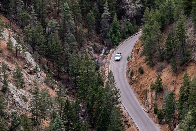 North cheyenne canyon canon colorado springs. Car traveling on mountain road highway through forest in north cheyenne canyon canon colorado springs mountain royalty free stock photos
