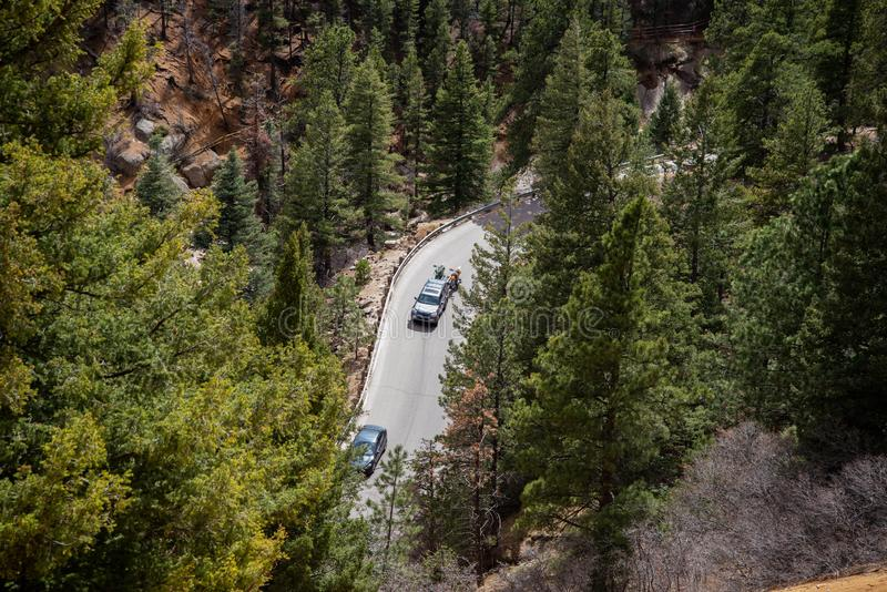 North cheyenne canyon canon colorado springs. Car traveling on mountain road highway through forest in north cheyenne canyon canon colorado springs mountain royalty free stock photo