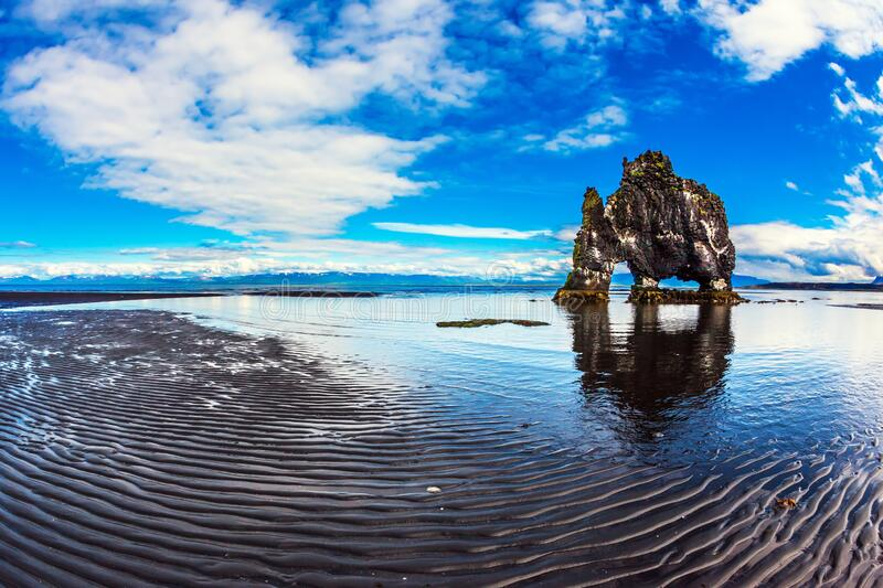North Coast Iceland. The famous Hvitserkur - basalt rock in the form of a huge mammoth. North Coast Iceland. The concept of extreme northern tourism royalty free stock photo