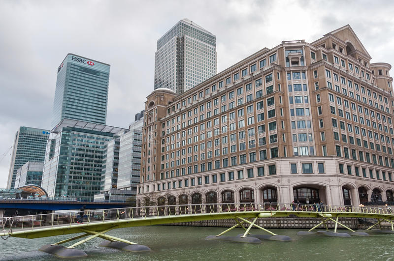 North Dock in Londons docklands on a cloudy day. LONDON, UNITED KINGDOM - NOVEMBER 8, 2014: Modern buildings in North Dock in London's docklands on a cloudy day stock photography