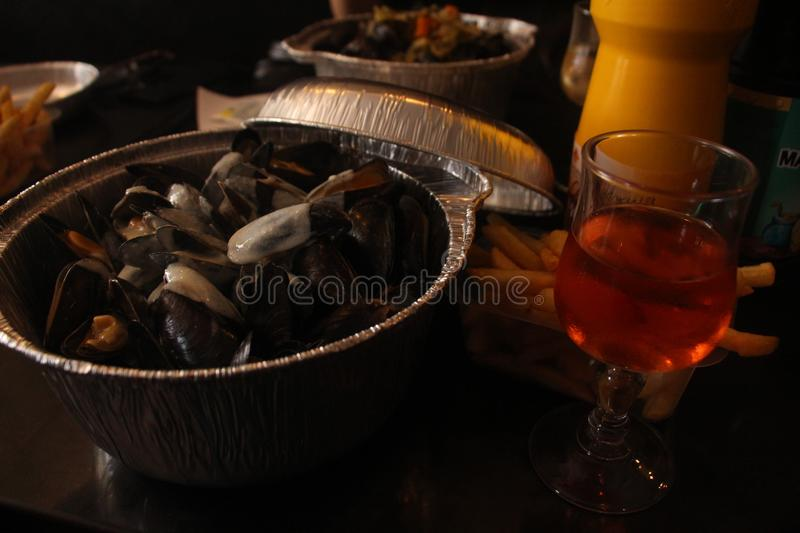 North French Belgian style mussle mule with rose wine stock photos