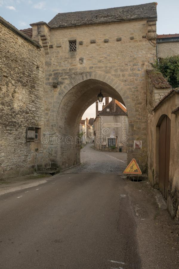 The north gate in the medieval village Noyers-sur-Serein. Sunset view of the north gate La Porte de Tonnerre, in the medieval village Noyers-sur-Serein, Burgundy stock photo