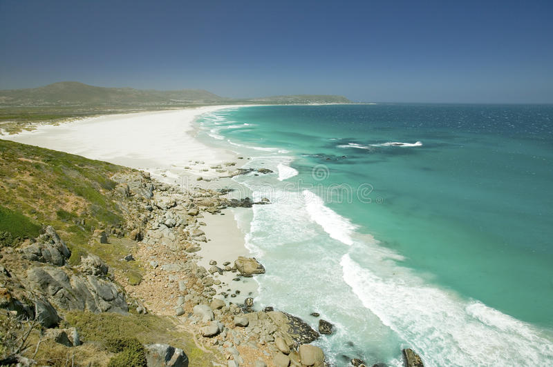 North of Hout Bay, Southern Cape Peninsula, outside of Cape Town, South Africa, a view of Atlantic Ocean and white sand beaches royalty free stock image