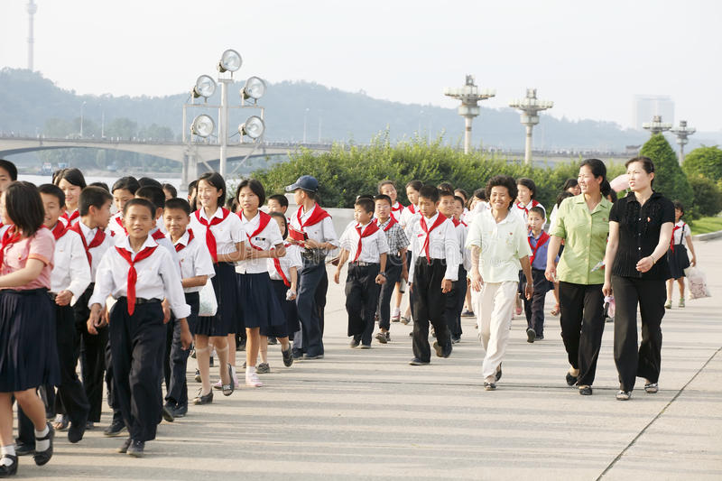 North korea 2011. North korea teachers and students walking in the Pyongyang street.They just participated in an important activity. Kim Il Sung died in July 8 royalty free stock photo