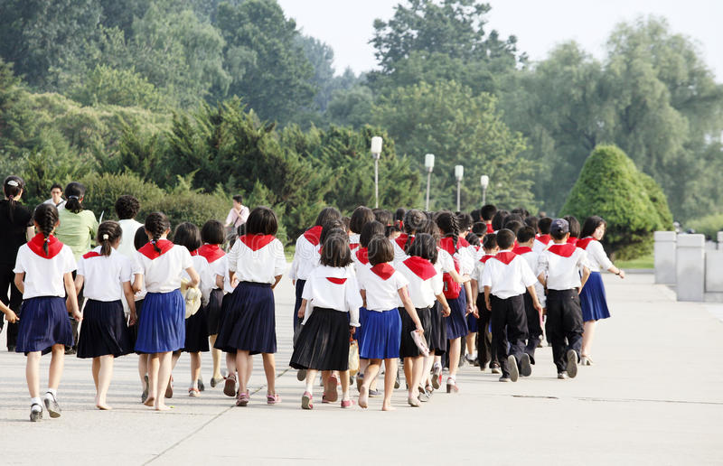 North korea 2011. North korean students are lining up to walk in the Pyongyang street.They just participated in an important activity. Kim Il Sung died in July 8 stock photos