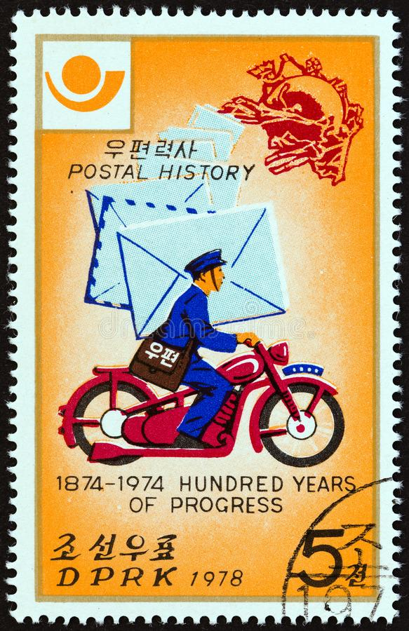NORTH KOREA - CIRCA 1978: A stamp printed in North Korea shows Postman on motorcycle, circa 1978. NORTH KOREA - CIRCA 1978: A stamp printed in North Korea from royalty free stock photography