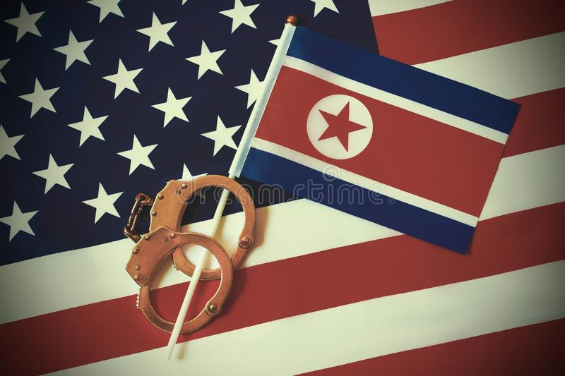 Flag of USA and North Korea. Handcuffs. Sanctions royalty free stock image