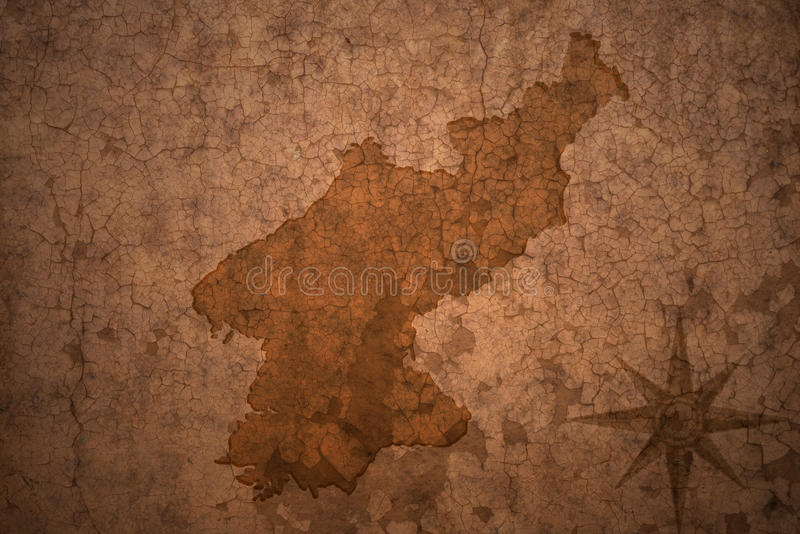 North korea map on vintage paper background. North korea map on a old vintage crack paper background stock photo