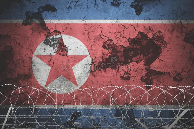 North korea national flag with grunge background and barb wire.  vector illustration