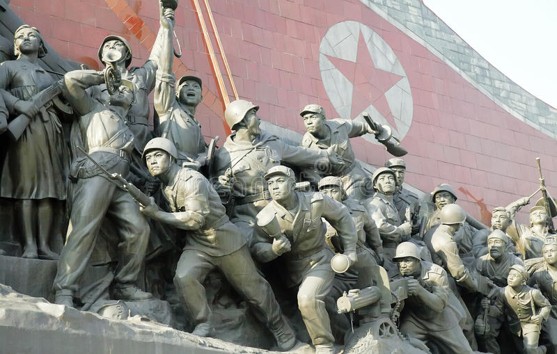 North Korea political sculpture. Large-scale sculpture on Kim Il Sung Square in Pyongyang.It depicts the North Korean army during the Korean War stock image
