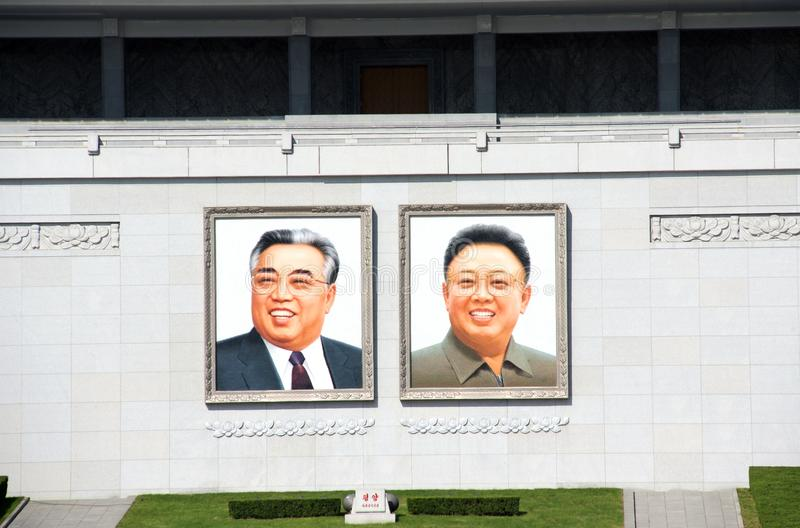 NORTH KOREA, PYONGYANG - SEPTEMBER 20, 2017: Portraits of two pr. Esidents DPRK Kim Il Sung and Kim Jong Il on Great People`s Study House, Kim Il Sung Square royalty free stock image