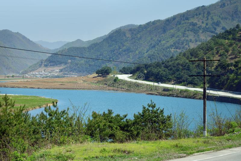 North Korea. Road and river stock photo