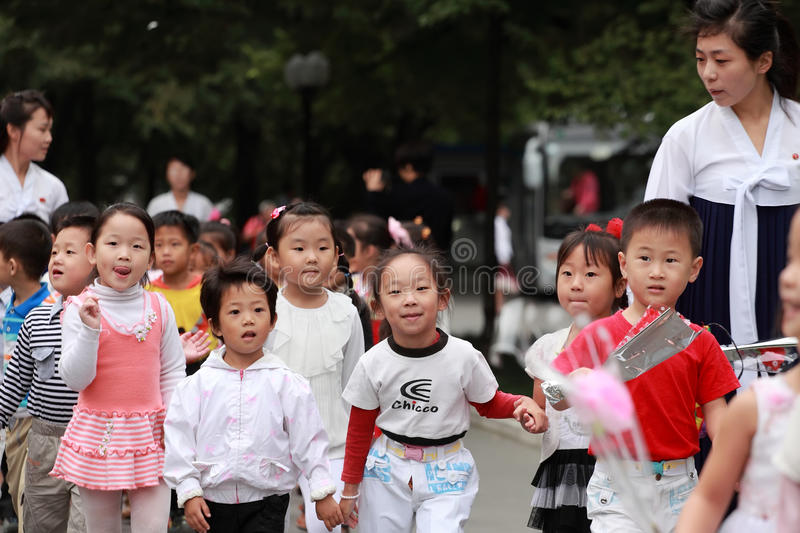 North Korea's children 2013. September 9 is north Korea's National Day, north Korea's people holding flowers came to miss their leaders in the meantime. it is a royalty free stock photo