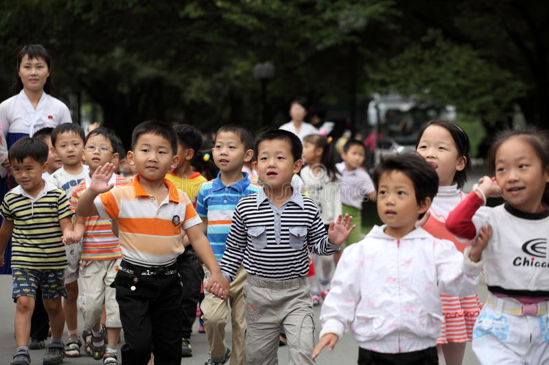 North Korea's children 2013. September 9 is north Korea's National Day, north Korea's people holding flowers came to miss their leaders in the meantime. it is a royalty free stock photography