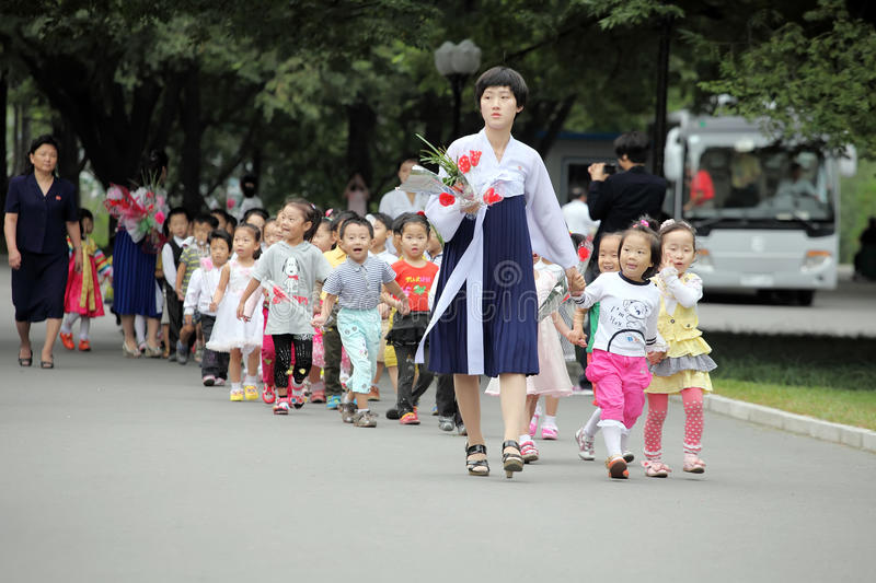 North Korea 2013. September 9 is north Korea's National Day, north Korea's people holding flowers came to miss their leaders in the meantime. it is a very stock photography