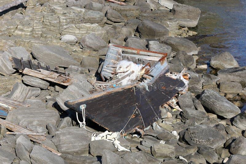 North Korean fishing boat wreck on Russky island, Tobizina Cape, Vladivostok, Russia. Wooden boat of korean fishermen broken by st. Orm stock image
