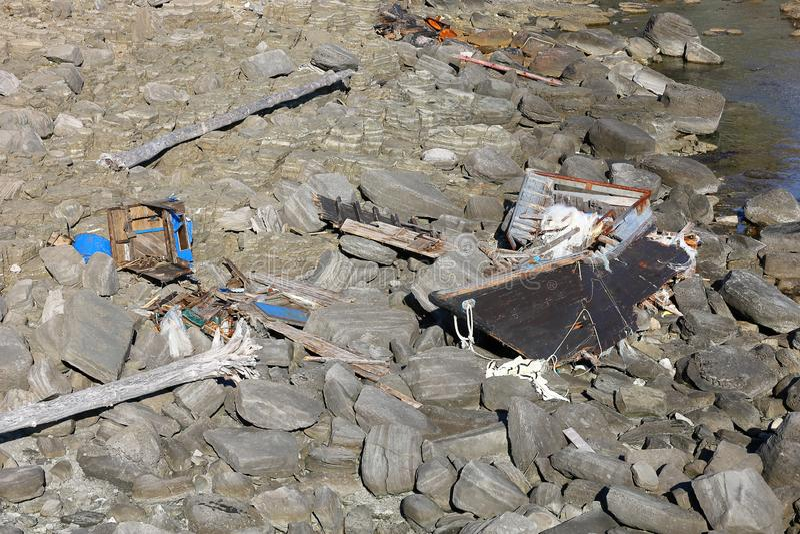 North Korean fishing boat wreck on Russky island, Tobizina Cape, Vladivostok, Russia. Wooden boat of korean fishermen broken by st. Orm stock photos